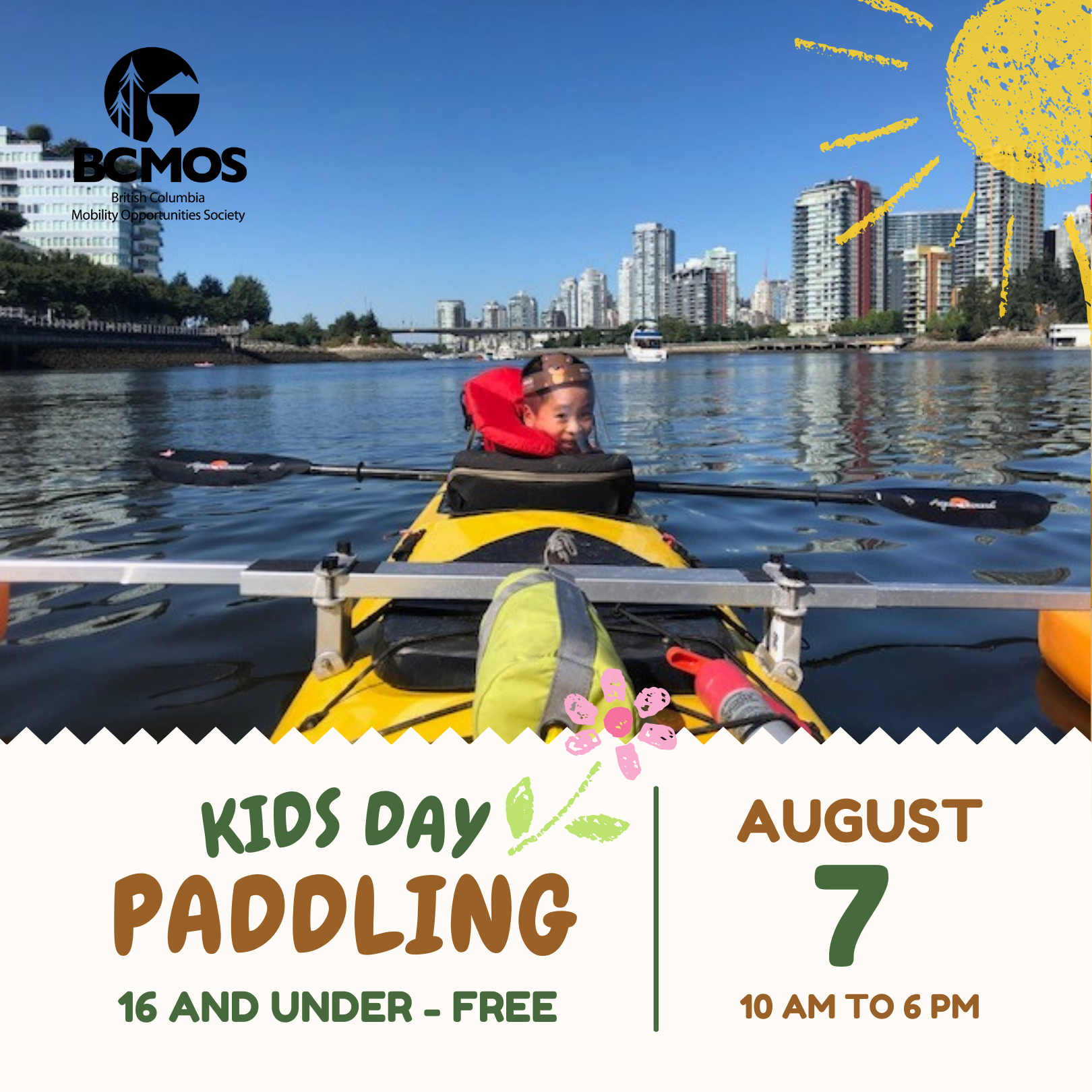 Young boy in the front seat of a kayak looking back at the camera. Kids day paddling, august 7th 10-6pm. 16 and under free.
